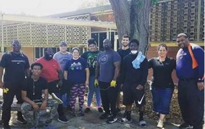 Eckerd Connects Project Bridge team and youth doing community service activity at the DJJ St. Petersburg Probation Office.