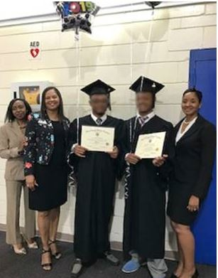 Natasha Clark-Jackson with the Duval County Public Schools, Reform Specialist Collins, two graduates, and Assistant Principal LaTonya Parker with the Duval County Public Schools