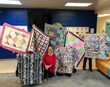 judge lynn tepper with quilt donations