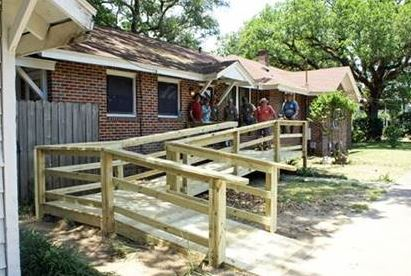 Youth and staff from AMIkids Pensacola build a wheelchair ramp.