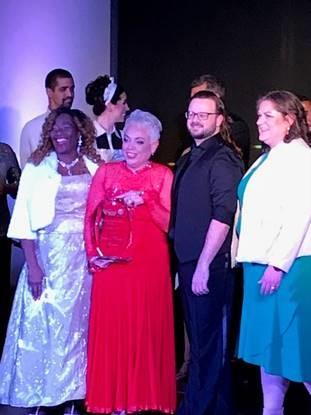 josie tomayo receiving award
