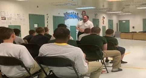 Ted DiBaise, Million Dollar Man, speaking to youth at Columbus Youth Academy.