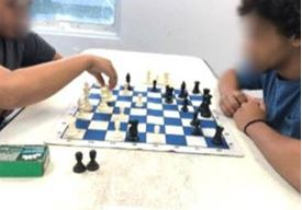 youth playing chess