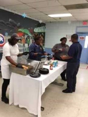 Palm beach staff hosting chicken and waffles lunch
