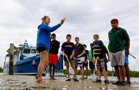 ami youth at boats