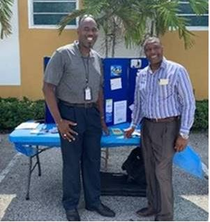 Johnny Sanders and Reverend Mike Roan, senior pastor of Dayspring Missionary Baptist Church