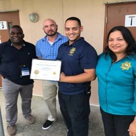 major Reginald Allen, Major Adrian Mathena, Maintenance Mechanic Jose Martinez, and Central Region Director Monica Gray