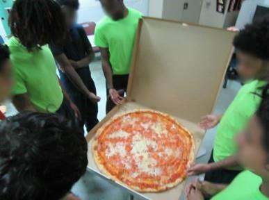 youth enjoying pizza