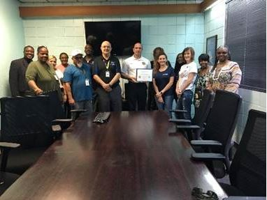 Major Adrian Mathena presented the teachers and nurses at the detention center with certificates of appreciation