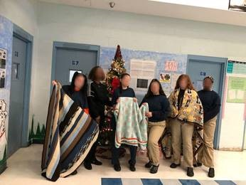 st lucie youth with blankets