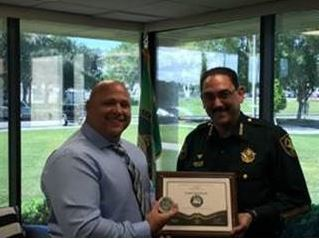 Marion County Sheriff Billy Woods presented CPO Randy Reynolds with an Eagle Eye Award for the excellent collaboration and teamwork between our agencies in Marion County.