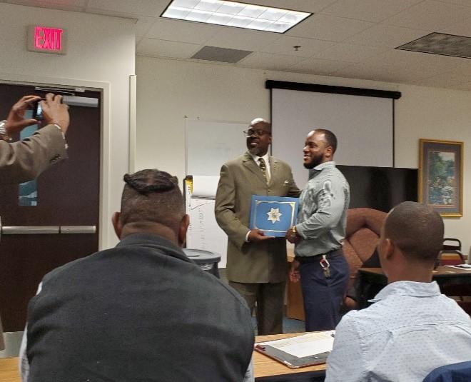 northeast director receiving award for team