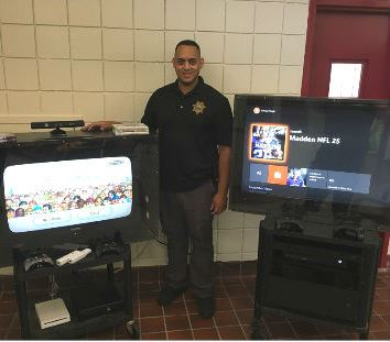Jose Martinez with portable behavior management gaming systems.