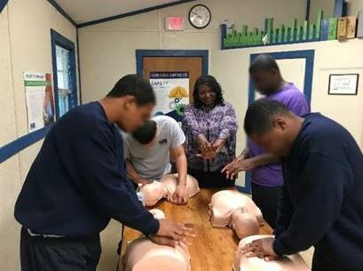 Students from Brooksville Academy in Adult First Aid/CPR/AED training.