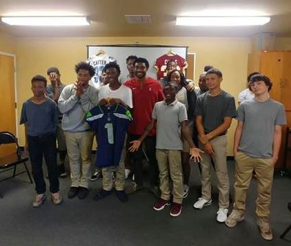 NFL player visits AMI youth