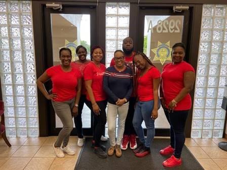 staff wearing red