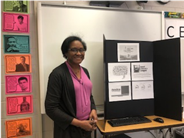 teacher with display